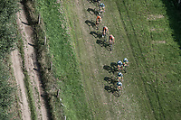 Team Wanty Group Gobert takes the lead over a grass covered off-road section. <br /> <br /> Antwerp Port Epic 2018 (formerly &quot;Schaal Sels&quot;)<br /> One Day Race: Antwerp &gt; Antwerp (207km of which 32km are cobbles &amp; 30km is gravel/off-road!)