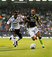 Bristol Rovers' Byron Moore takes on Fulham's Steven Sessegnon during the Carabao Cup match between Fulham and Bristol Rovers at Craven Cottage, London, England on 22 August 2017. Photo by Carlton Myrie.