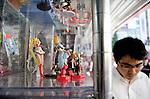 """August 30, 2011 - Tokyo, Japan - A man walks past a display of figurines in Akihabara. Akihabara is a well-known district in Tokyo for people who have obsessive interests particularly in manga, anime or video games. The Japanese term used for these types of people is called """"otaku."""" (Photo by Yumeto Yamazaki/AFLO)"""