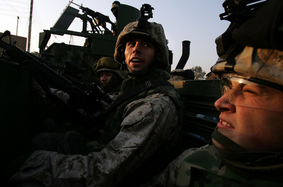 Riding in a 7-ton truck, Marines with 1st Platoon Golf Company 2nd Battalion 5th Marines return to their base Hurricane Point from the search of a cemetery and nearby park for hidden weapons caches on January 17, 2005 in Ramadi, Iraq. The search resulted in the discovery of several mortar rounds which were destroyed in place.