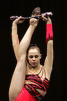 Galina Shyrkina of Ukraine holds balance with clubs at San Francisco Invitational on February 11, 2006. Shyrkina took 2nd All-Around. (Photo by Tom Theobald)