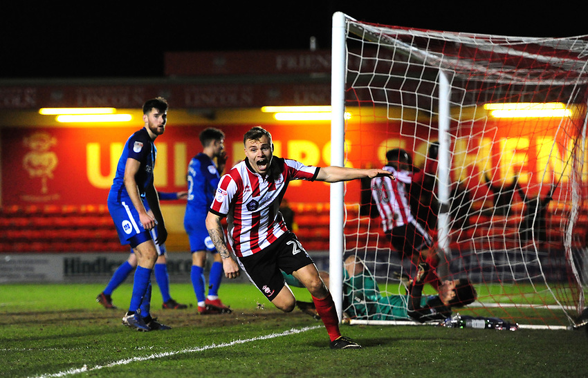 Lincoln City's Harry Anderson celebrates scoring his sides third goal<br /> <br /> Photographer Chris Vaughan/CameraSport<br /> <br /> The EFL Checkatrade Trophy Fourth Round - Lincoln City v Peterborough United - Tuesday 23rd January 2018 - Sincil Bank - Lincoln<br />  <br /> World Copyright &copy; 2018 CameraSport. All rights reserved. 43 Linden Ave. Countesthorpe. Leicester. England. LE8 5PG - Tel: +44 (0) 116 277 4147 - admin@camerasport.com - www.camerasport.com