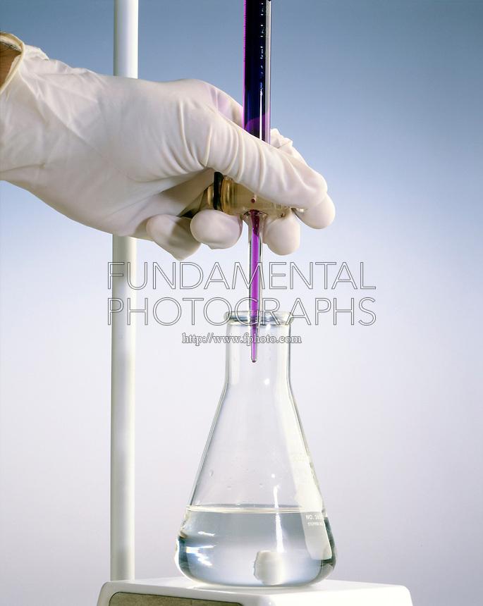 POTASSIUM PERMANGANATE &amp; SODIUM OXALATE (1 of 3)<br /> KMnO4 In Buret Added To C2H2O4(aq) In Flask<br /> A reduction oxidation titration
