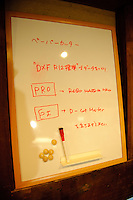 Whiteboard with laboratory notes, FabLab, Kamakura, Kanagawa Pref, Japan, December 9, 2011.
