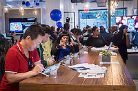 Visitors try out Samsung products, including the Galaxy Note 4, in a Samsung pop-up shop in Soho in New York on the phablet's release date, Friday, October 17, 2014. Samsung released the new Galaxy Note 4 today going head to head with the Apple iPhone 6 Plus in what is being called the phablet wars. (© Richard B. Levine)