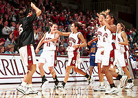 STANFORD, CA - FEBRUARY 3: Jamie Carey, Milena Flores and the team during Stanford's 83-68 win over the UCLA Bruins on February 3, 2000 at Maples Pavilion in Stanford, California.