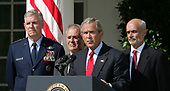 Washington, D.C. - September 3, 2005 -- United States President George W. Bush delivers his weekly radio address live from the Rose Garden on September 3,2005. Left to right: Chairman of the Joint Chiefs of Staff Richard Myers, United States Air Force, United States Secretary of Defense Donald Rumsfeld, The President, and Secretary of the United States Department of Homeland Security Michael Chertoff. <br /> Credit: Dennis Brack - Pool via CNP