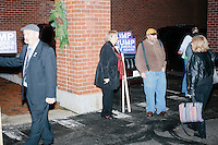 Supporters of Republican presidential candidate and real estate mogul Donald Trump gather outside of the Sheraton Portsmouth Harborside Hotel in Portsmouth, New Hampshire, USA. At the hotel that evening, the New England Police Benevolent Association endorsed Trump for president. A small group of perhaps 20 Trump supporters stood outside the hotel and there was a larger group of anti-Trump protesters, mostly across the street. One of the protest organizers estimated that there were around 230 protesters gathered.Many protesters expressed disagreement with Trump's recent statements that he would ban all Muslims from entering the country. Trump brought up the recent shooting in San Berdardino, Calif., at the meeting.