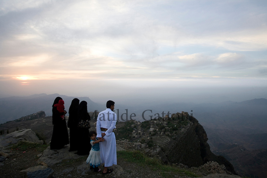 Yemen - Yemeni family enjoying the sunset over the mountains. Yemen's economy depends heavily on oil production, and its government receives the vast majority of its revenue from oil taxes. Yet analysts predict that the country's petroleum output, which has declined over the last seven years, will fall to zero by 2017. The government has done little to plan for its post-oil future. Yemen's population, already the poorest on the Arabian peninsula and with an unemployment rate of 35%, is expected to double by 2035..The trends will exacerbate large and growing environmental problems, including the exhaustion of Yemen's groundwater resources. Given that a full 90% of the country's water is used for agriculture, this trend portends disaster..Sanaa's well are expected to dry out by 2015, partly due to illegal drilling, partly because 40% of the city's water is diverted for qat production, and partly because conservation rules are difficult to enforce. Only 20% of the houses receive water, the other 80% has to collect it from pumps and wells. 15% of the urban population only uses bottled water as its primary drinking water source and that is why Yemen has one of the highest world mortality rate, most of the diseases being related to water..
