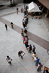 Fukushima city, April 27 2011 - .(eng) Food distribution for dinner outside the shelter. More than 2 months after the earthquake, 700 people are still refugees in this shelter...(fr) Distribution de nourriture a l'exterieur du gymnase de Fukushima. Pres de deux mois apres le seisme, 700 personnes sont encore refugies dans le gymnase.