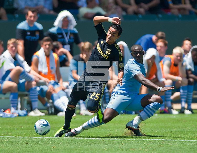 CARSON, CA – July 24, 2011: LA Galaxy midfielder Miguel Lopez (25) during the match between LA Galaxy and Manchester City FC at the Home Depot Center in Carson, California. Final score Manchester City FC 1 and LA Galaxy 1. Manchester City wins shoot out 7, LA Galaxy 6.