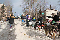 Jodi Bailey and team run past spectators on the bike/ski trail with an Iditarider in the basket during the Anchorage, Alaska ceremonial start on Saturday, March 5, 2016 Iditarod Race. Photo by O'Hara Shipe/SchultzPhoto.com