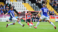 Lincoln City's Jack Payne under pressure from Sheffield Wednesday's Julian Borner<br /> <br /> Photographer Chris Vaughan/CameraSport<br /> <br /> Football Pre-Season Friendly - Lincoln City v Sheffield Wednesday - Saturday July 13th 2019 - Sincil Bank - Lincoln<br /> <br /> World Copyright © 2019 CameraSport. All rights reserved. 43 Linden Ave. Countesthorpe. Leicester. England. LE8 5PG - Tel: +44 (0) 116 277 4147 - admin@camerasport.com - www.camerasport.com