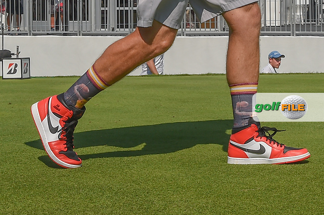 Paul Casey's (ENG) caddie, Johnny Long Socks Mclaren riled up the Akron, Ohio gallery as he wore socks depicting former Cleveland Cavalier star Lebron James socks today during 2nd round of the World Golf Championships - Bridgestone Invitational, at the Firestone Country Club, Akron, Ohio. 8/3/2018.<br /> Picture: Golffile | Ken Murray<br /> <br /> <br /> All photo usage must carry mandatory copyright credit (© Golffile | Ken Murray)