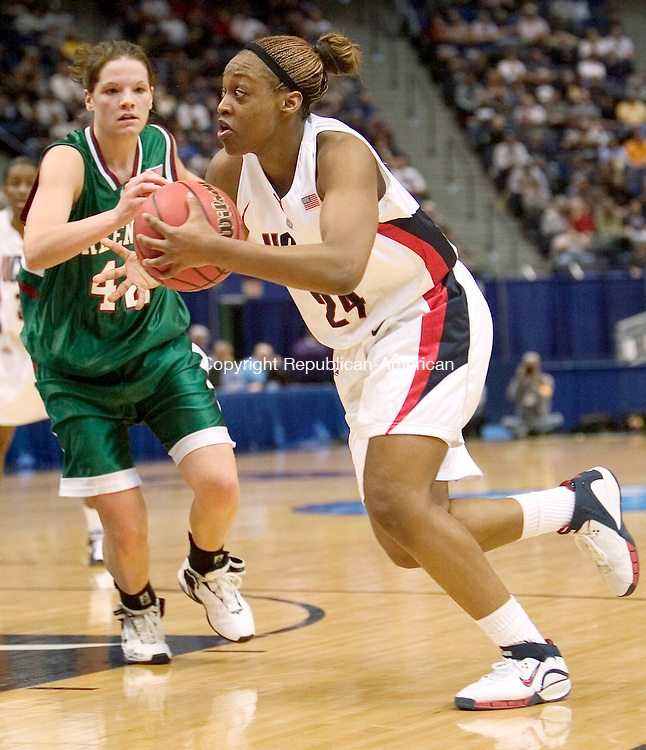 HARTFORD, CT. 20 March 2007-032007SV06--#24 Charde Houston of UConn looks to the hoop as #42 Amanda Popp of Wisconsin Green Bay defends during the second round of NCAA action at the Civic Center in Hartford Tuesday.<br /> Steven Valenti Republican-American