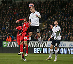 David Wheater of Bolton out jumps Fabio Borini of Liverpool - FA Cup Fourth Round replay - Bolton Wanderers vs Liverpool - Macron Stadium  - Bolton - England - 4th February 2015 - Picture Simon Bellis/Sportimage