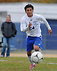 North Babylon No. 24 Kevin Benitez races downfield during a Suffolk County varsity boys' soccer Class AA first round playoff game against Ward Melville at North Babylon High School on Tuesday, October 27, 2015. Ward Melville won by a score of 1-0.<br /> <br /> James Escher