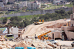 Israeli bulldozers work in the jewish settlement of Pisgat Zeev in East Jerusalem, Tuesday, April 5, 2011. A group of prominent Israelis is presenting an informal new peace proposal, hoping to breathe life into deadlocked talks with the Palestinians. In the proposal, the Palestinian state would encompass Gaza and the West Bank, with territorial swaps to allow large Israeli settlement blocs to remain. Jerusalem would be shared, and Palestinian refugees would return only to the new Palestinian state, with a few exceptions. April 05 2011. Photo by Sliman Khader