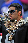 21 September 2008: An Oakland Raiders fan watches his team play the Buffalo Bills at Ralph Wilson Stadium in Orchard Park, NY. The Bills rallied for 10 unanswered points in the 4th quarter to defeat the Raiders 24-23...Mandatory Photo Credit: Ed Wolfstein Photo