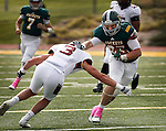 SPEARFISH, SD - OCTOBER 8, 2016 -- Zane Lindsey #87 of Black Hills State tries to hold off Colorado Mesa tackler Colby Dixon #3  during their football game at Lyle Hare Stadium in Spearfish, S.D. Saturday. (Photo by Dick Carlson/Inertia)
