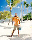 USA, Florida, portrait of a mid adult man standing on beach with fishing rod and tackle box, Islamorada