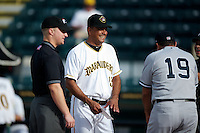 Bradenton Marauders Carlos Garcia #13, umpire Garrett Patterson (left), Luis Sojo #19 before a Florida State League game against the Tampa Yankees at McKechnie Field on July 19, 2012 in Bradenton, Florida.  Bradenton defeated Tampa 4-3.  (Mike Janes/Four Seam Images)