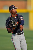 Right fielder Justin Ellison (5) of the Rome Braves warms up before a game against the Greenville Drive on Tuesday, August 30, 2016, at Fluor Field at the West End in Greenville, South Carolina. Greenville won, 7-3. (Tom Priddy/Four Seam Images)