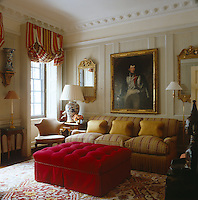 A small panelled drawing room reveals its Georgian origins