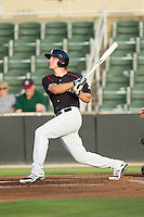 Carl Thomore (13) of the Kannapolis Intimidators connects on a grand-slam against the Delmarva Shorebirds at CMC-NorthEast Stadium on July 2, 2014 in Kannapolis, North Carolina.  The Intimidators defeated the Shorebirds 6-4. (Brian Westerholt/Four Seam Images)