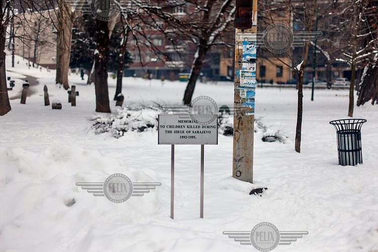 An information sign at the monument for children killed during the siege of Sarajevo between 1992 and 1995. 521 names are written on the memorial.