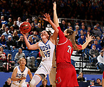 BROOKINGS, SD - DECEMBER 3: Ellie Thompson #45 from South Dakota State takes the ball to the basket past Kylee Shook #21 from Louisville during their game Sunday afternoon at Frost Arena in Brookings, SD.  (Photo by Dave Eggen/Inertia)