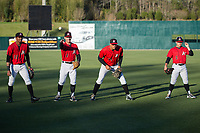 (L-R) Joel Booker (23),  Max Dutto (6), Antonio Rodriguez (14), and Tyler Sullivan (2) play a game of pepper prior to the South Atlantic League game against the Lakewood BlueClaws at Kannapolis Intimidators Stadium on April 8, 2017 in Kannapolis, North Carolina.  The BlueClaws defeated the Intimidators 8-4 in 10 innings.  (Brian Westerholt/Four Seam Images)