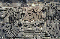 Bas-relief on the side of Pyramid of the Feathered Serpent at the ruins of Xochicalco near Cuernavaca, Morelos, Mexico.This seated figure is thought to have been a ruler or governor. Xochicalco flourished between 700 and 900 AD and was once one of the most important ciities in Mesoamerica. Xochicalco was declared a UNESCO World Heritage Site in 1999.