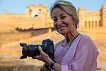 India, Jaipur, Historical City, photographer Jami Tarris in front of Jaipur Fort