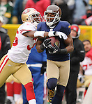 Green Bay Packers receiver Greg Jennings, right, hauls in a long touchdown catch ahead of San Francisco 49ers' Shawntae Spencer during the second quarter of the game at Lambeau Field in Green Bay, Wis., on Dec. 5, 2010.