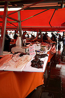 Raw fish and minke whale meat on sale at  Fisktorget, fish and seafood market in central Bergen, Norway