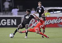 DC United midfielder Clyde Simms (19) makes a pass while cover by Toronto FC. midfielder Amado Guevarra (20).   DC United tied Toronto FC. 3-3 at  RFK Stadium, Saturday May 9, 2009.
