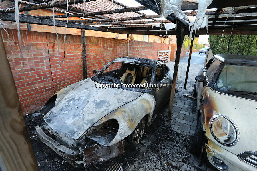 BNPS.co.uk (01202 558833)<br /> Pic: RichardCrease/BNPS<br /> <br /> ***Please use full byline***<br /> <br /> Crime novelist Andrew Towning fears life is imitating art after an arsonist torched his Porsche car in a copycat attack of one of his storylines.<br /> <br /> The best-selling author believes the offender was inspired to set fire to his &pound;18,000 Porsche Carrera after reading one of his Jake Dillon crime-thriller novels.<br /> <br /> The blaze caused a small explosion and sent flames 10ft into the air.<br /> <br /> In his 2010 book 'Shroud of Concealment', the lead character has his own Porsche 911 car blown up in the street after being targeted by a underworld crime gang.<br /> <br /> Now Mr Towning fears he has been singled out by one of his readers following the attack at his home in Merley, near Wimborne, Dorset.