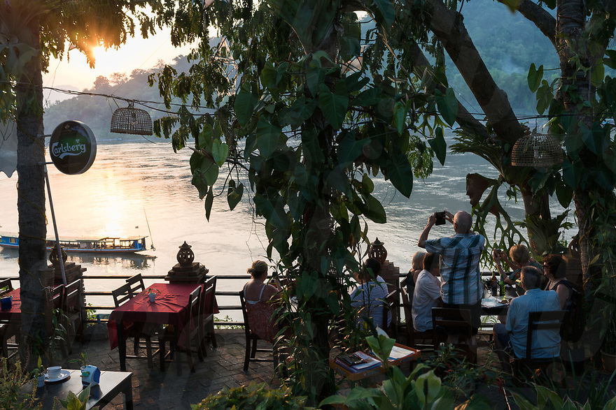 May 08, 2017 - Luang Prabang (Laos). People enjoy the sunset over the Mekong river from one of the cafe on the river front. © Thomas Cristofoletti / Ruom
