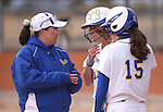 Western Nevada College's head softball coach Leah Wentworth talks with Wildcats Makaylee Jaussi and Katilyn Covione during a game against College of Southern Idaho in Carson City, Nev., on Friday, Feb. 27, 2015. <br /> Photo by Cathleen Allison/Nevada Photo Source