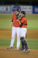 Kannapolis Intimidators catcher Ryan Plourde (2) chats with relief pitcher David Trexler (27) on the mound during the game against the Lakewood BlueClaws at CMC-Northeast Stadium on May 16, 2015 in Kannapolis, North Carolina.  The BlueClaws defeated the Intimidators 9-7.  (Brian Westerholt/Four Seam Images)