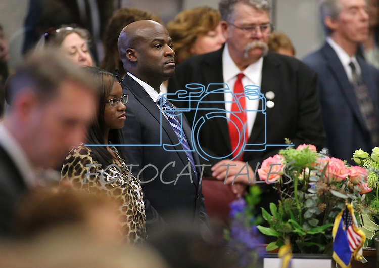 Nevada Senators Kelvin Atkinson, D-North Las Vegas, center and Pete Goicoechea, R-Eureka, listen to proceedings on the opening day of the 77th Legislative Session in Carson City, Nev. on Monday, Feb. 4, 2013. (AP Photo/Cathleen Allison)