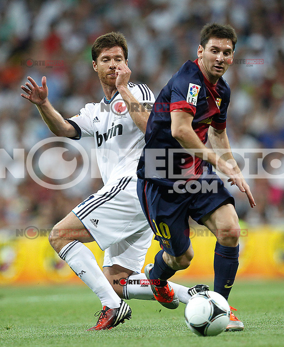 Real Madrid's Xabi Alonso and F.C. Barcelona's Lionel Messi during Spanish Supercup 2nd match on august 29 2012...Photo: Cesar Cebolla / ALFAQUI /NortePhoto.com<br />