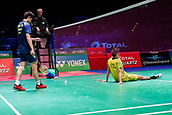 18th March 2018, Arena Birmingham, Birmingham, England; Yonex All England Open Badminton Championships; Lin Dan (CHN) dives and turns his back on the wrong end of a net cord in the mens singles  final against Shi Yuqi (CHN)