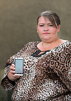 FAO NIGEL BARKLIE, DAILY MAIL PICTURE DESK<br /> Pictured: Lisa Howells with her son Mikey's phone at her home in Carmarthen. Thursday 14 July 2016<br /> Re: Lisa Howells from Carmarthen, west Wales is angry after a TT Sims mobile phone she bought for her son Mikey from Tesco seems to have infections that cannot be removed, making the phone access porn sites even after factory re-sets have been done.