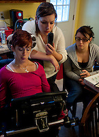 Kara and personal assistants work to arrange transport after her van was damaged in an accident. Kara is a healthcare advocate for the non-profit organization Arise  where she works to help people with disabilities obtain healthcare and make the transition to independant living. Photo by James R. Evans©