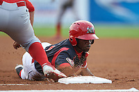Batavia Muckdogs shortstop Anfernee Seymour (3) dives back to first during a game against the Williamsport Crosscutters on August 29, 2015 at Dwyer Stadium in Batavia, New York.  Williamsport defeated Batavia 7-3.  (Mike Janes/Four Seam Images)