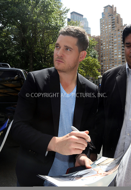 WWW.ACEPIXS.COM<br /> <br /> September 9 2013, New York City<br /> <br /> Singer Michael Buble arrives at a midtown hotel on his 38 th birthday on September 9 2013 in New York City<br /> <br /> By Line: Philip Vaughan/ACE Pictures<br /> <br /> ACE Pictures, Inc.<br /> tel: 646 769 0430<br /> Email: info@acepixs.com<br /> www.acepixs.com