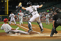 Phillies 3B Pedro Feliz slides home on Thursday May 22nd at Minute Maid Park in Houston, Texas. Photo by Andrew Woolley / Four Seam Images..