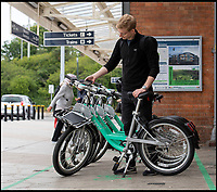 BNPS.co.uk (01202 558833)<br /> Pic: PhilYeomans/BNPS<br /> <br /> Customers unlock the bikes with a simple app.<br /> <br /> An innovative bike share scheme has been wheeled out in a popular seaside resort as part of a bid to reduce congestion.<br /> <br /> The Beryl Bikes, which can be hired through a smartphone app, will be dotted around designated bays in Bournemouth and Poole, Dorset.<br /> <br /> It is the first time cycling firm Beryl have offered a citywide bike-hire service and will aim to reduce traffic in the bustling coastal region.